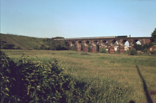 Train travelling over Sankey Viaduct