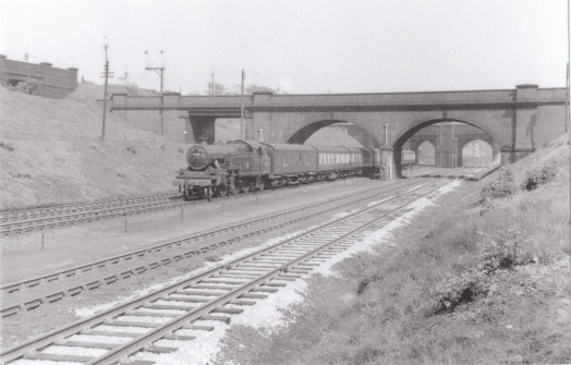 Train passing under a bridge